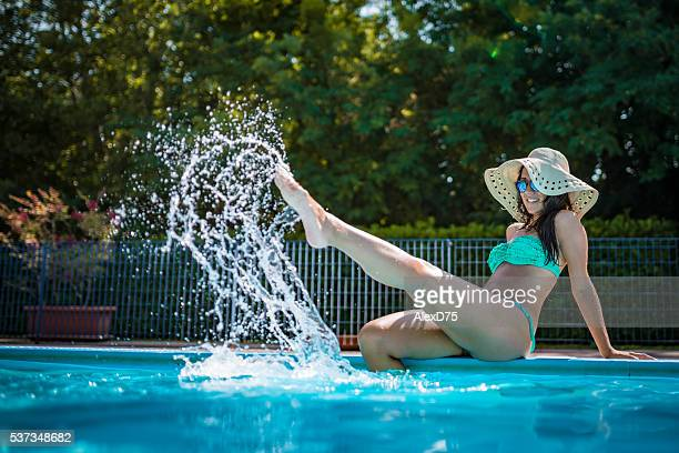 beauty on the pool side - hot legs stock photos and pictures