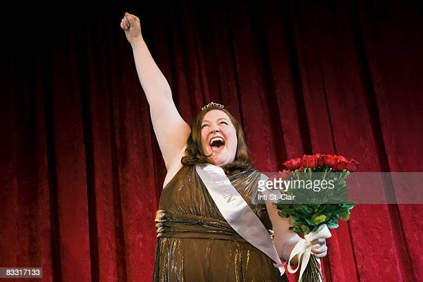 beauty pageant winner celebrating  - fat woman funny stock photos and pictures