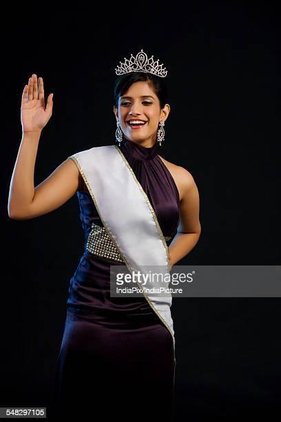 Beauty pageant winner waving