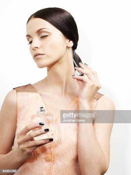 beauty perfume wand side of neck - applying stock pictures, royalty-free photos & images