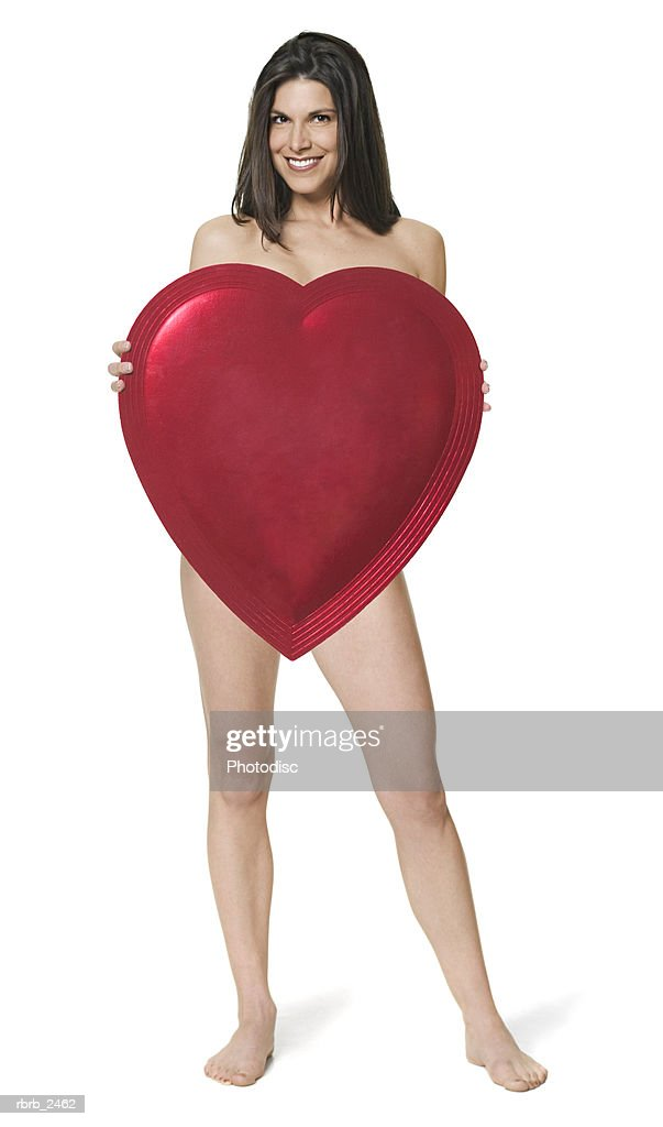 beauty portrait of a nude adult woman holding up a giant heart : Foto de stock