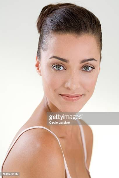 beauty portrait of a smiling woman - hair back stock pictures, royalty-free photos & images