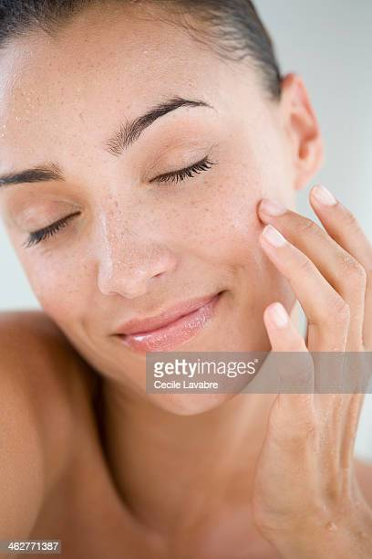 Beauty portrait of a woman with wet face