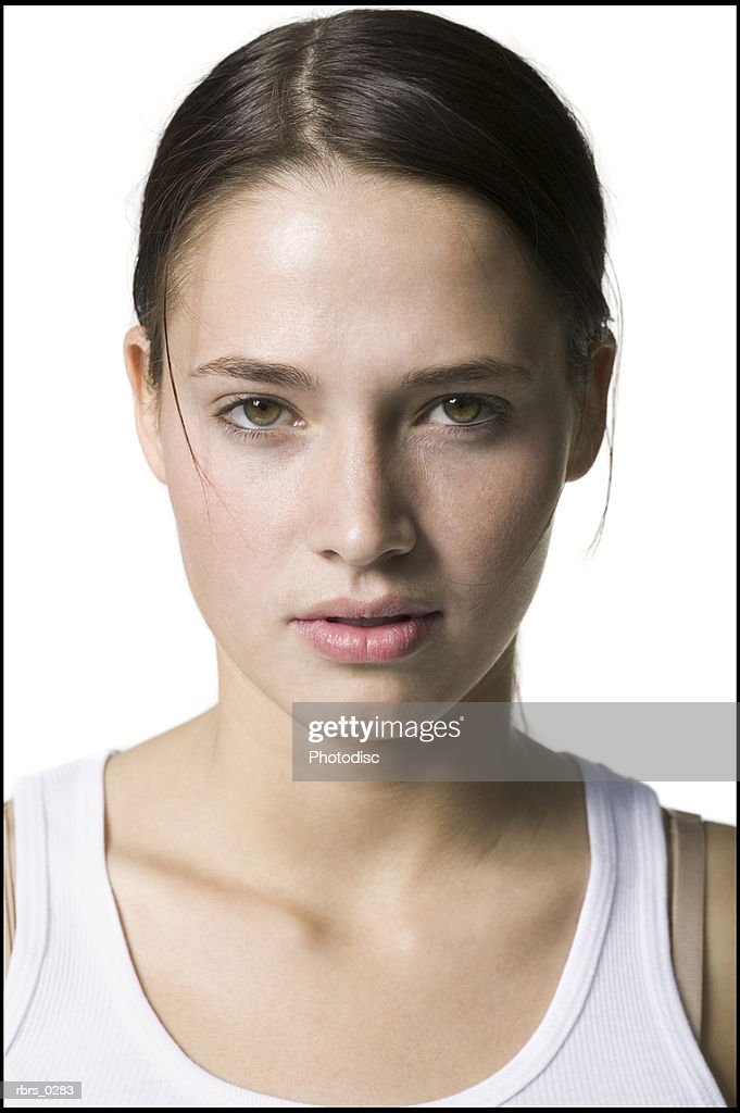 beauty portrait of a young adult woman in a white tank top as she looks into the camera : Foto de stock