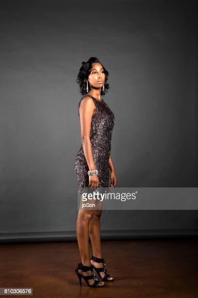 beauty portrait of a young african american woman - mini dress stock pictures, royalty-free photos & images