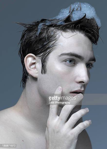 Beauty portrait of a young man washing his hair