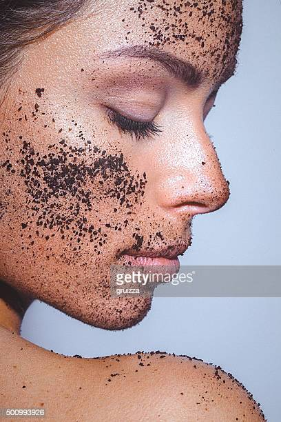 beauty portrait of a young woman with clean healthy skin - ground coffee stock photos and pictures