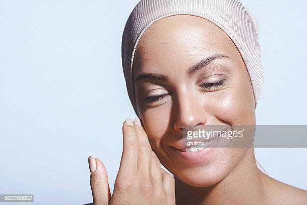 Beauty portrait of a young woman with superb healthy skin