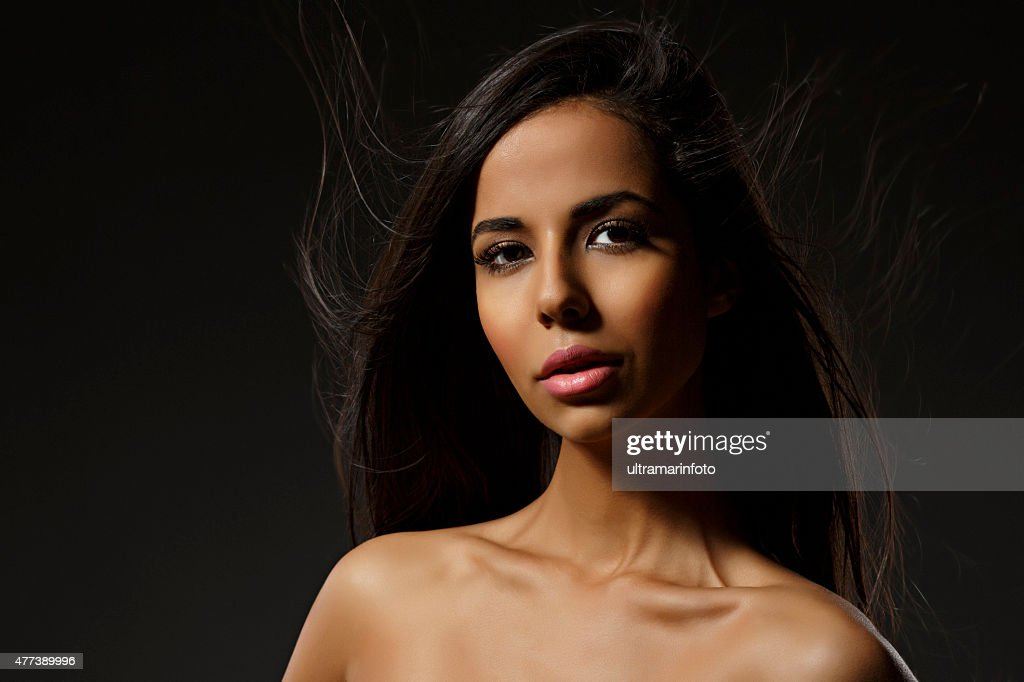 Beauty portrait of Beautiful  mixed-race young  woman with long hair : Stock Photo