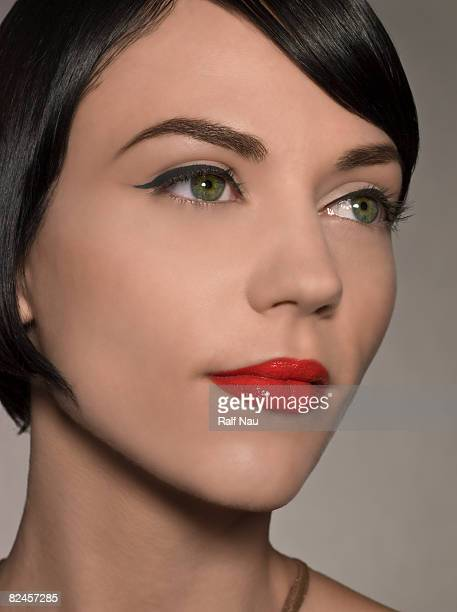 Beauty portrait of female with red lips