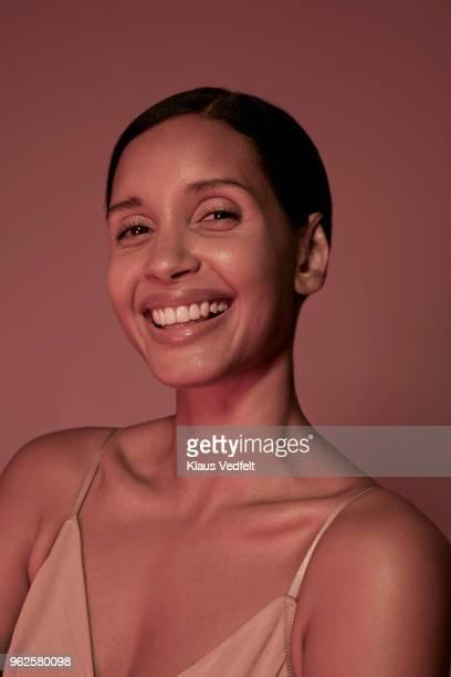 beauty portrait of laughing woman in underwear - getönt stock-fotos und bilder
