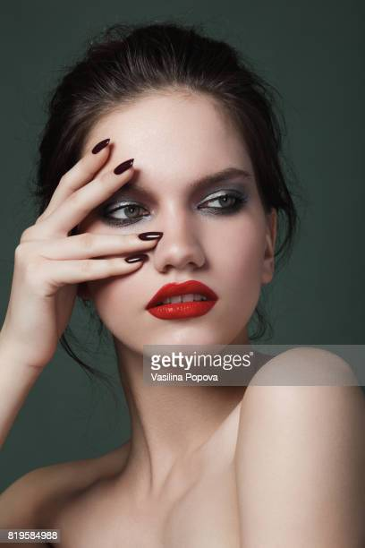 beauty portrait of sensual woman - black nail polish stock photos and pictures