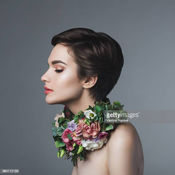 Beauty portrait of woman with floral necklace