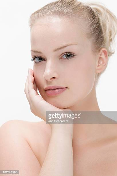 Beauty portrait of woman with hand on chin