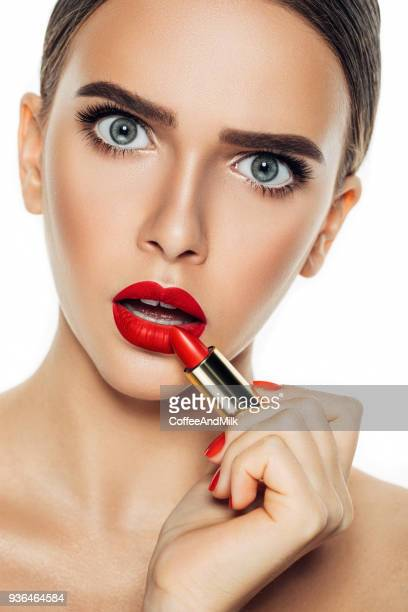 beauty portrait of woman with lipstick - red lipstick stock pictures, royalty-free photos & images