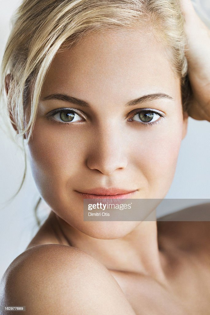Beauty portrait of young blond woman, close-up : Stock Photo