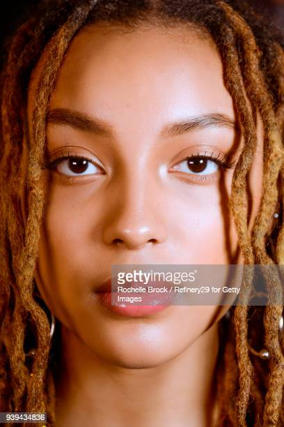 Beauty Portrait of Young Confident Woman with Dreadlocks