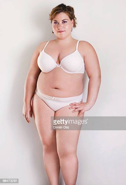 beauty portrait of young plus-size woman - fat blonde women stock photos and pictures