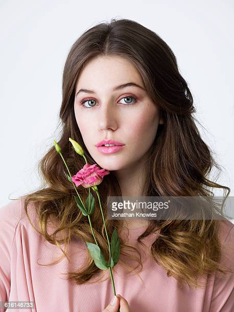beauty portrait,female with a flower - wavy hair stock pictures, royalty-free photos & images