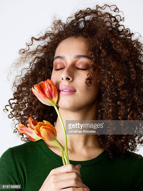 Beauty portrait,female with tulips, eyes closed