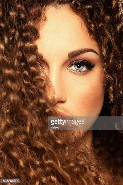 Beauty portrat of girl with curly hair