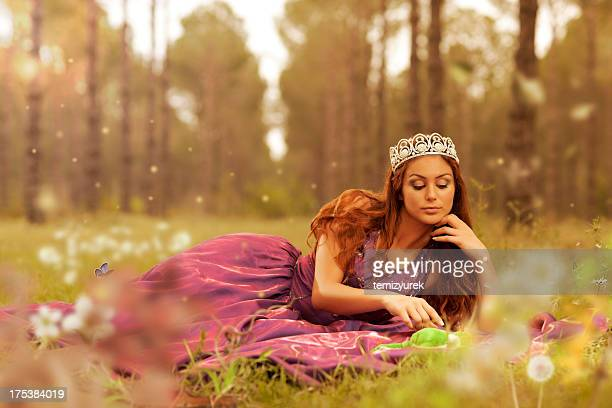 Beauty princess with frog in forest