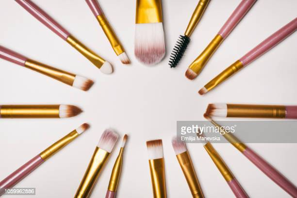 beauty products knolling - eye liner stock photos and pictures