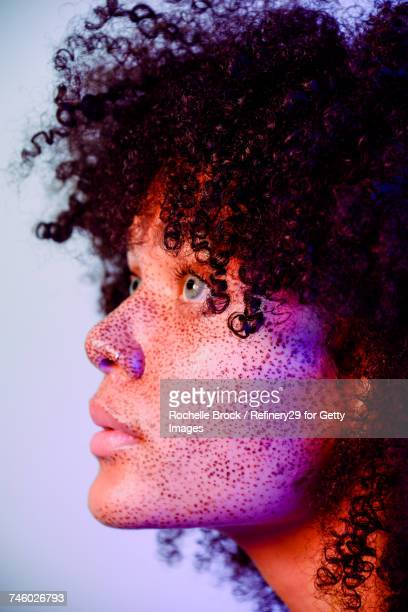 Beauty Profile of a Young Confident Woman with Freckles