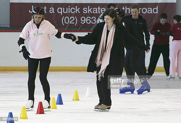 "Beauty Queen Belinda Green is assisted by Monica Aubrecht during a training session in preparation for the new TV series ""Skating On Thin Ice"" at the..."