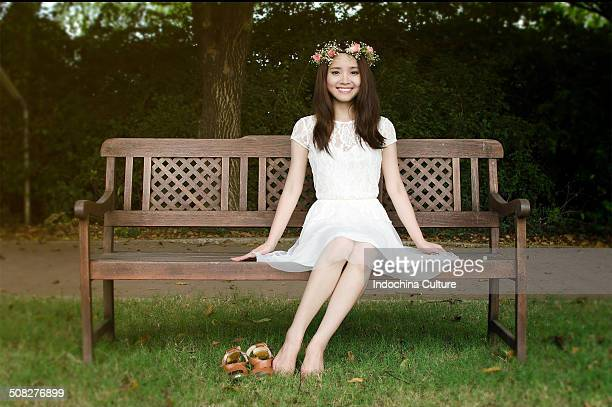 Beauty Queen sitting on a wooden chair