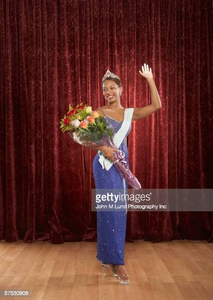 Beauty queen waving to the audience