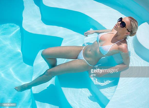 beauty relaxing in the pool - gorgeous babes stock photos and pictures
