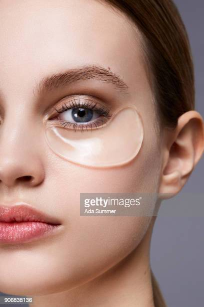 beauty shot of a beautiful woman with collagen eye mask