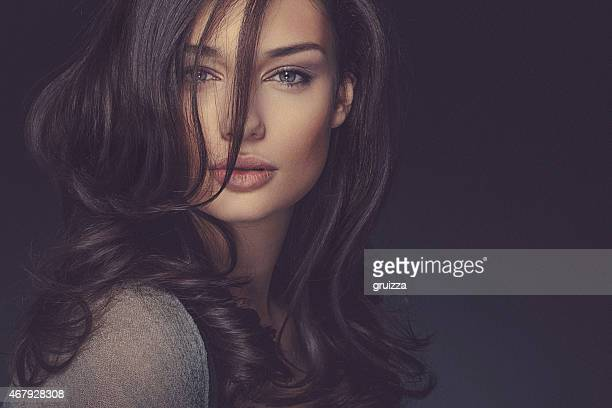 beauty shot of a smiling long haired, beautiful brunette woman - model stock photos and pictures