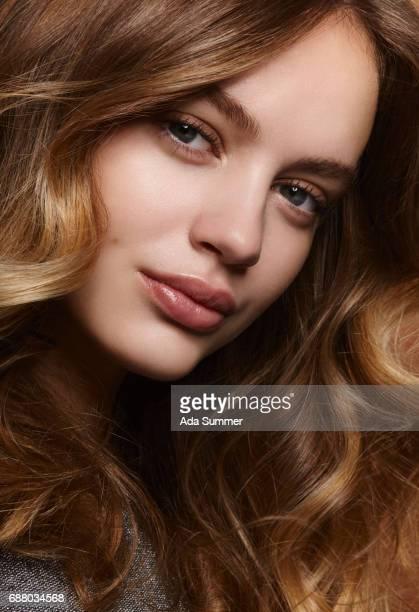 Beauty shot of a young brunette with long wavy hair
