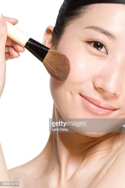 Beauty shot of a young woman with a blusher