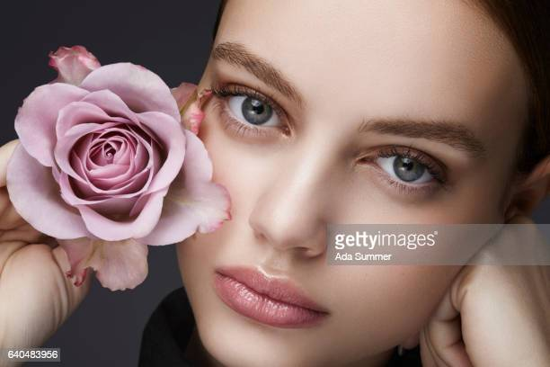 Beauty shot of a young woman with a rose in her hand