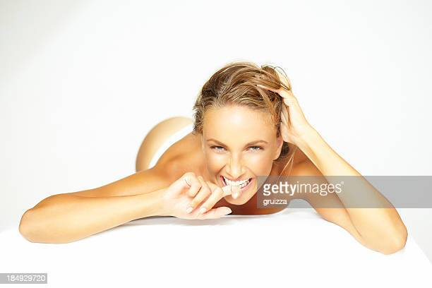 beauty shot of beautiful, blonde woman relaxing on massage table - sensual massage stock photos and pictures