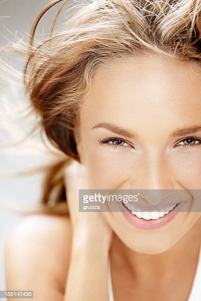 Beauty shot of beautiful blonde woman smiling on the wind