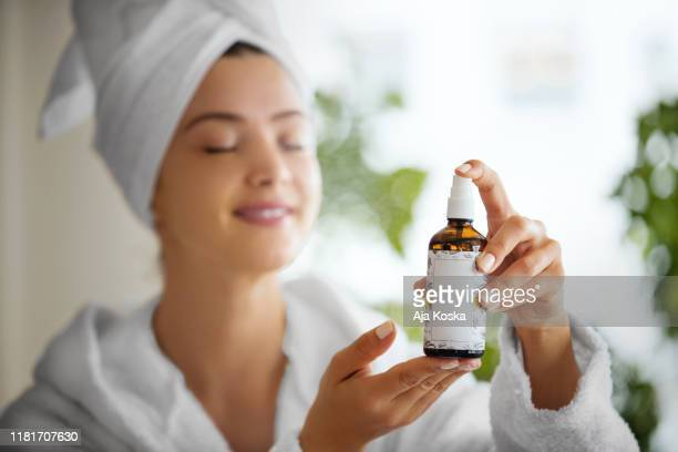 beauty spa time. - essential oil stock pictures, royalty-free photos & images