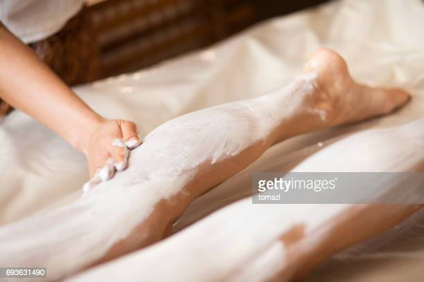 Beauty spa treatment of letgs with mud