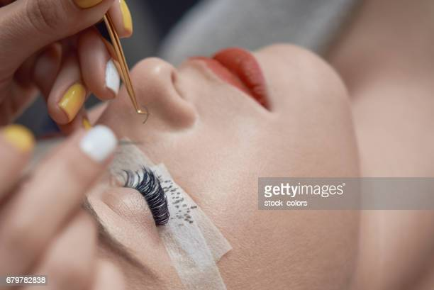 beauty treatment, applying false eyelashes