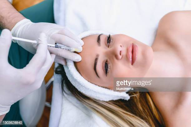 beauty treatment with botox - forehead stock pictures, royalty-free photos & images