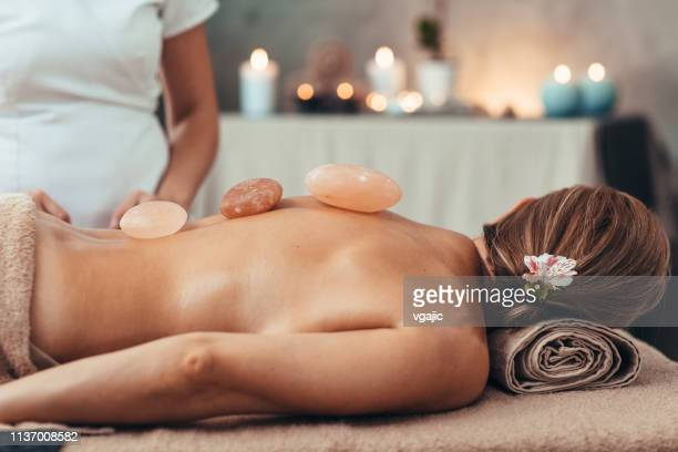 beauty treatments and massage - himalayan salt stock pictures, royalty-free photos & images