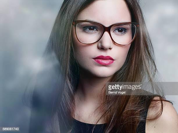 beauty with eyeglasses looking in camera - occhiali da vista foto e immagini stock