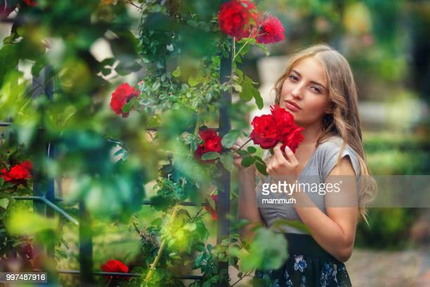 beauty with red roses in tuscany, italy - southern european descent stock pictures, royalty-free photos & images