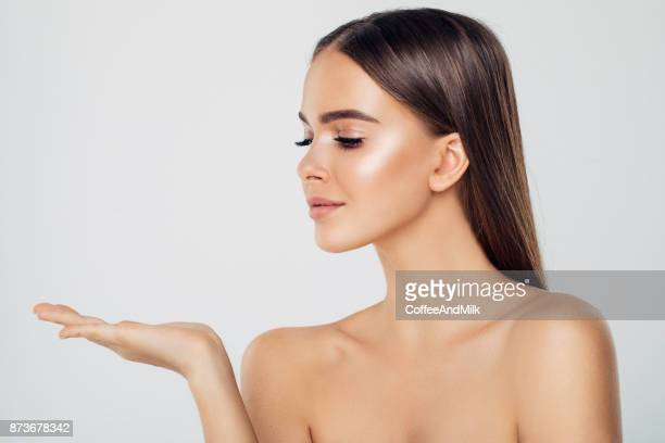 beauty woman showing something - innocence stock pictures, royalty-free photos & images