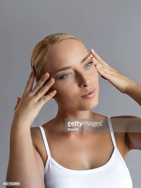 Beauty woman tightening a face with her hands.