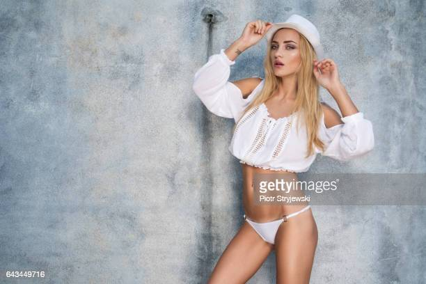 Beauty woman with perfect body over wall