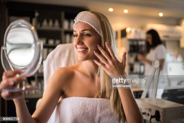 beauty women looking at the mirror - girl in mirror stock photos and pictures